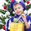 Little boy in prince carnival suit opening christmas gift — Stock Photo