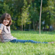 Cheerful girl resting in the park — Stock Photo