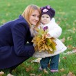 Happy mother and her little daughter — Stock Photo