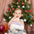 Cheerful girl with her christmas present — Stockfoto