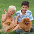 Stock Photo: Two boys plus two pets