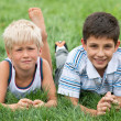 Thoughtful and smiling boys — Stock Photo
