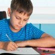 Drawing boy at the desk - 图库照片
