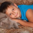 Smiling boy with a cat — Stock Photo
