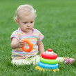 Serious little girl on the grass — Stock Photo