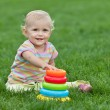 Smiling little girl with a toy pyramid — Stock Photo