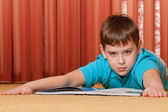 Serious boy with a book — Stock Photo