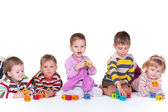 Five children playing blocks — Stock Photo