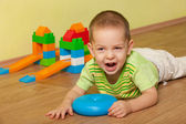Shouting kid in the children room — Stock Photo