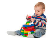 Kid building a toy house — Stock Photo
