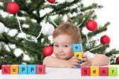 "Cute toddler holding ""happy new year"" sign — Stock Photo"