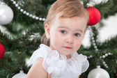 Pretty toddler at the new year tree — Stock Photo