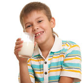 Handsome boy with a glass of milk — Stock Photo