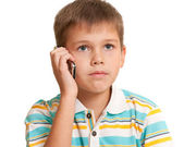 Serious kid talking on the phone — Stock Photo