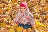 Little girl in the yellow leaves — Stock Photo