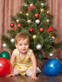 Vibrant toddler at the christmas tree — Stock Photo