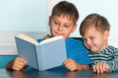Two reading boys at the desk — Stock Photo