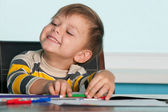 Successful little boy at the desk — Stockfoto