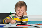 Smiling drawing little boy — Stock Photo