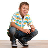 Squatting kid — Stock Photo