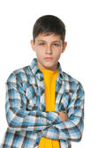Confident teenager in checked shirt — Stock Photo