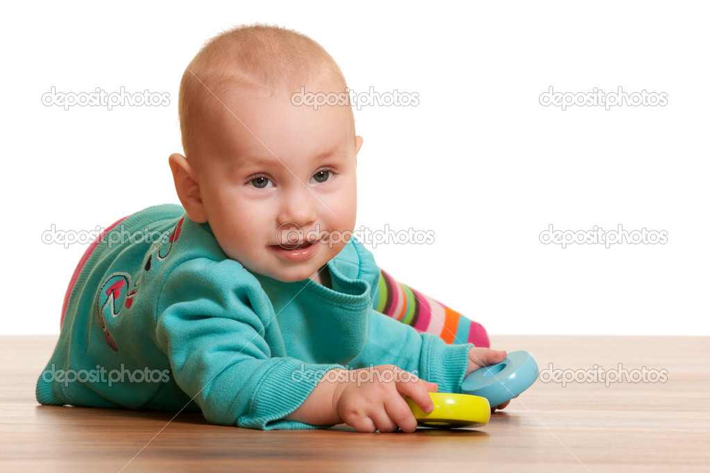 A closeup portrait of a little girl in blue holding toy pyramid circles isolated on the white background — Stock Photo #8143701