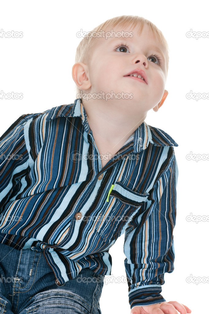 A handsome toddler is looking up with great interestisolated on the white background — Stock Photo #8143958