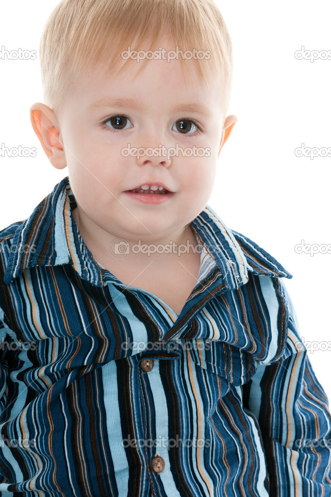 A cut out portrait of a handsome cheerful kid in a striped shirt isolated on the white background — Stock Photo #8143960