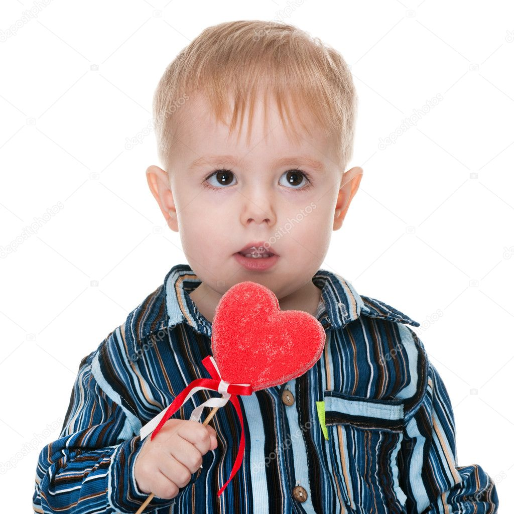 A handsome toddler with a red valentines heart isolated on the white background — Stock Photo #8143962