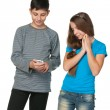 Stock Photo: Fashion teenagers with a cell phone