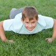 Training athletic kid - Stock Photo