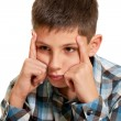 Stock Photo: Thoughtful kid holding his head with his fingers