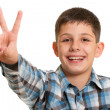 Stock Photo: Happy boy showing a victory sign