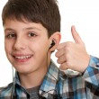 Happy learner showing thumb up - Stock Photo