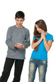 Fashion teenagers with a cell phone — Stock Photo