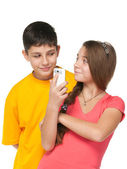 A portrait of fashion kids with a cell phone — Stock Photo