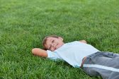 Happy boy on the green grass — Stock Photo