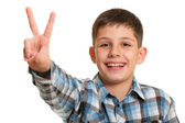 Happy boy showing a victory sign — Stock Photo