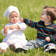 Two toddlers on the grass - Foto Stock