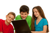 Happy kids playing with the laptop — Stock Photo