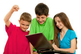 Children with laptop — Stock Photo