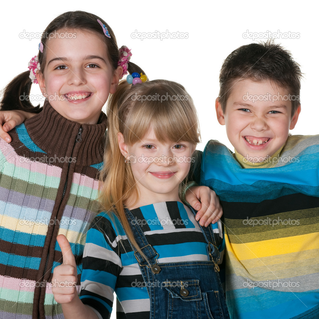 Closeup portrait of three laughing kids in striped sweaters isolated on the white background — Stock Photo #8629174