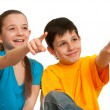 Smiling children pointing forward — Stock Photo