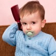 Toddler with a comb — Stock Photo