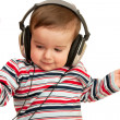 Kid in striped shirt with headphones and red heart - Stock Photo