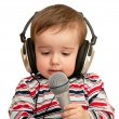 Given a speech toddler with headphones and microphone, closeup — Stock Photo
