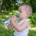 Drinking water toddler — Stock Photo