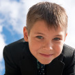 Portrait of a smiling kid outdoors — Stock Photo