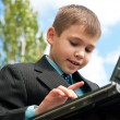 Boy studies outside — Stock Photo