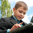Boy studies outside — Stock Photo #8634569